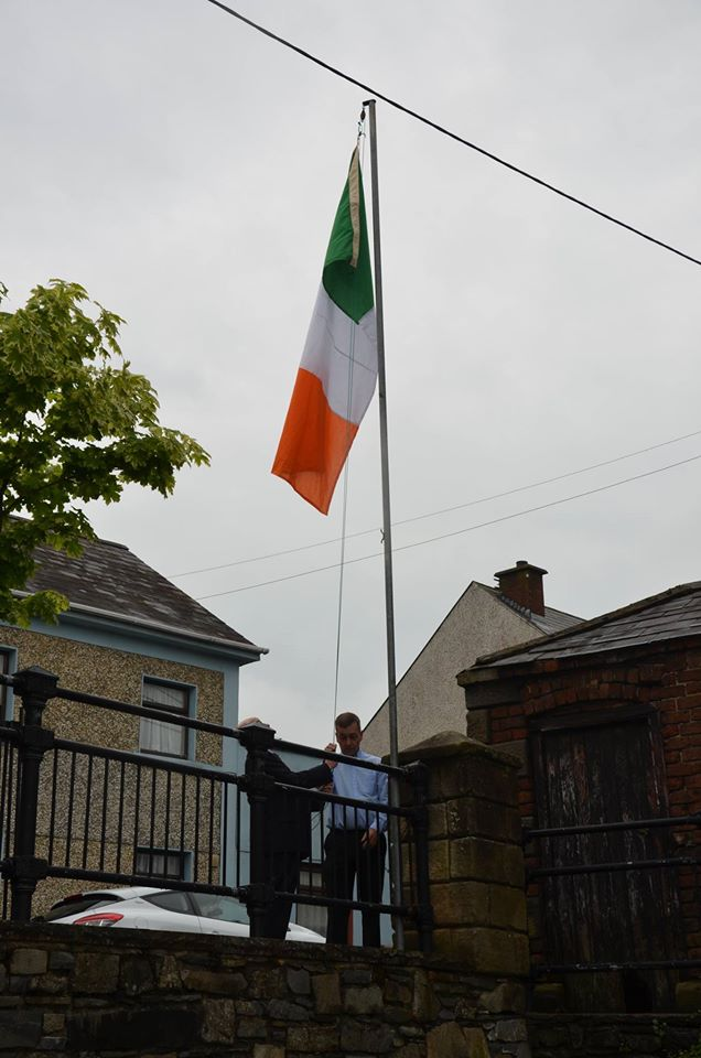 Eamon and Rory raise the flag